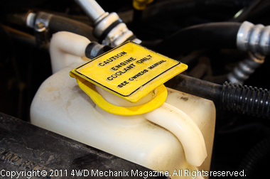 Check coolant overflow bottle and anti-freeze protection