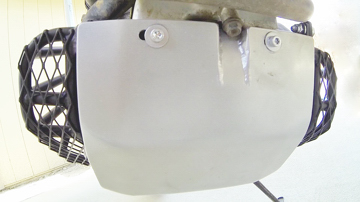 TCI Products metal skid plate and durable engine side guards on the Honda XR650R dual-sport motorcycle