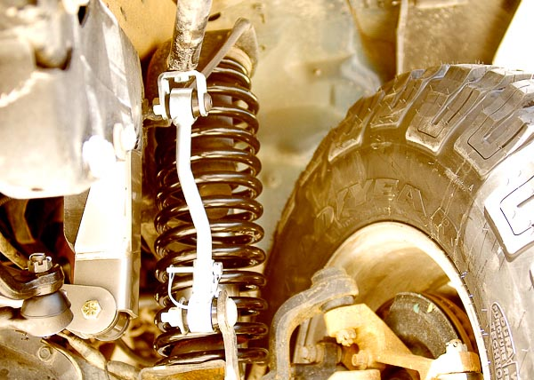 Turn and cycle wheels and tires when checking clearance.